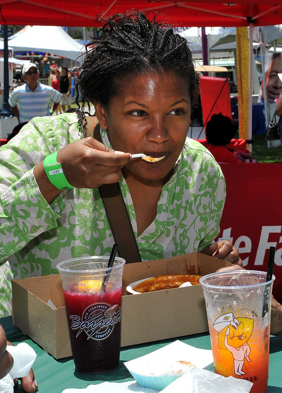 . 6/22/13 - Christina Lewis enjoys codfish etouffe  during the  27th Annual Long Beach Bayou and Blues Festival at Rainbow Harbor. Photo by Brittany Murray / Staff Photographer