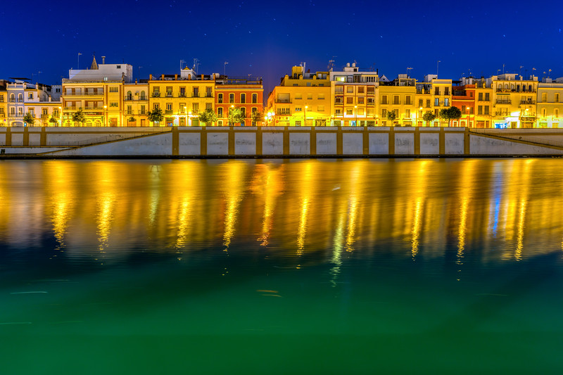 Betis street by the Guadalquivir river at night, Seville, Spain.