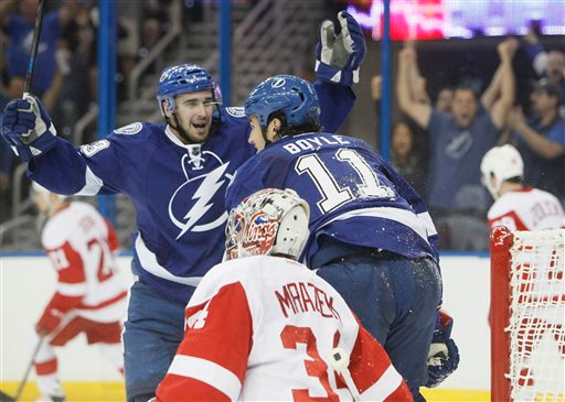 . Tampa Bay Lightning center Brian Boyle (11) celebrates with Cedric Paquette (13) after Boyle scored on Detroit Red Wings goalie Petr Mrazek (34) during the first period in Game 1 of an NHL hockey first-round playoff series, Thursday, April 16, 2015, in Tampa, Fla. (Dirk Shadd/Tampa Bay Times via AP)