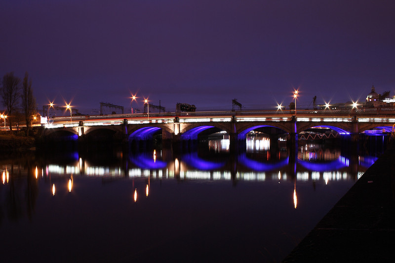 Glasgow Bridge at night with the Caledonian Railway Clyde Viaduct in behind.