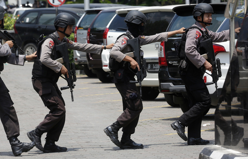 . Police officers take their position near the site where an explosion went off in Jakarta, Indonesia Thursday, Jan. 14, 2016. Suicide bombers exploded themselves in downtown Jakarta on Thursday while gunmen attacked a police post nearby, a witness told The Associated Press. Local television reported more explosions in other parts of the city. (AP Photo/Dita Alangkara)