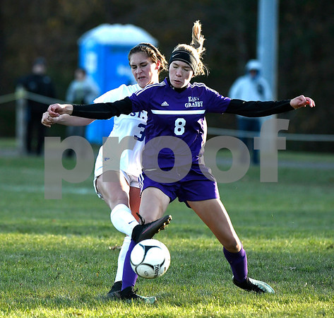 11/11/2017 Mike Orazzi | Staff St. Paul's Briana Senese (38) and East Granby's Caitlin Strzegowski (8) during the Class S Quarterfinals held at St. Paul Catholic High School Saturday. St. Paul won 2-1 in double overtime.
