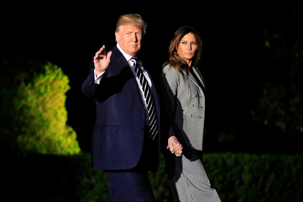 . President Donald Trump, with first lady Melania Trump, leaves the White House in Washington, early Thursday, May 10, 2018, to greet three freed Americans detained in North Korea for over a year, who are arriving at Joint Base Andrews, Md. (AP Photo/Manuel Balce Ceneta)