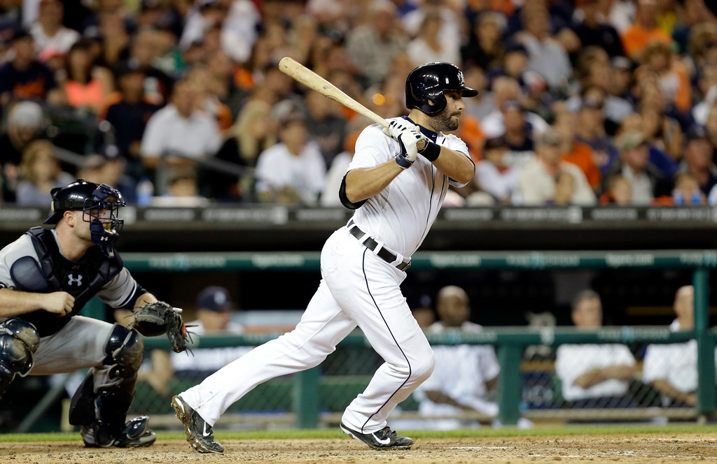 . Detroit Tigers\' Alex Avila hits into a double play scoring J.D. Martinez against the New York Yankees in the sixth inning of a baseball game in Detroit Tuesday, Aug. 26, 2014. (AP Photo/Paul Sancya)