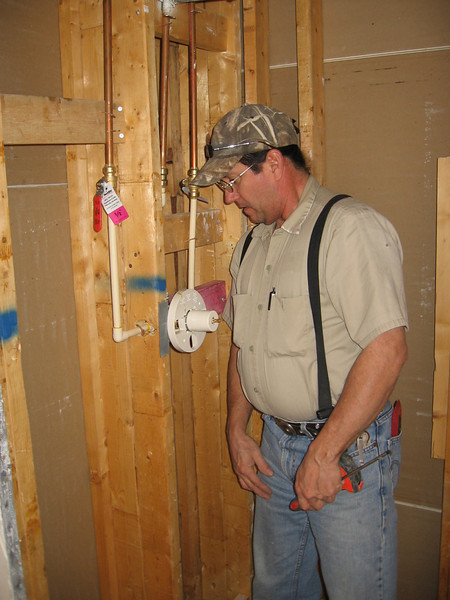 """Willie: """"I hope that damn thing doesn't leak after we've tiled over it""""."""