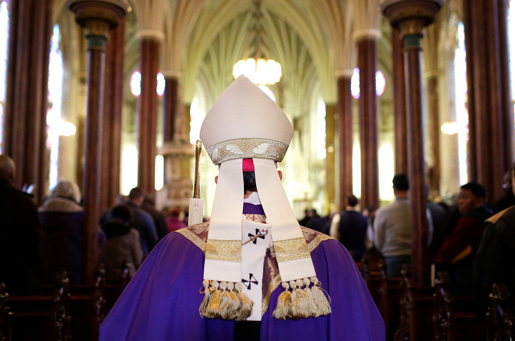 . Baltimore Archbishop William Lori walks into an Ash Wednesday Mass, Wednesday, Feb. 18, 2015, in Baltimore. Ash Wednesday marks the start of the Lent, a season of prayer and fasting for Christians before Easter. (AP Photo/Patrick Semansky)