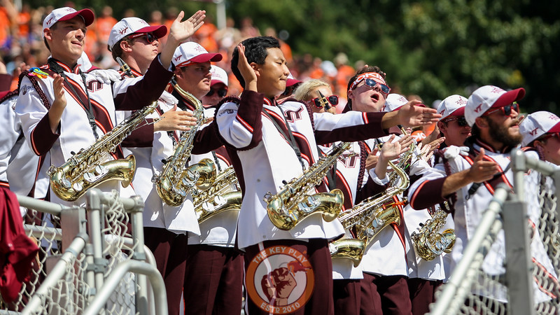 Members of the Marching Virginians perform during a break in the action. (Mark Umansky/TheKeyPlay.com)