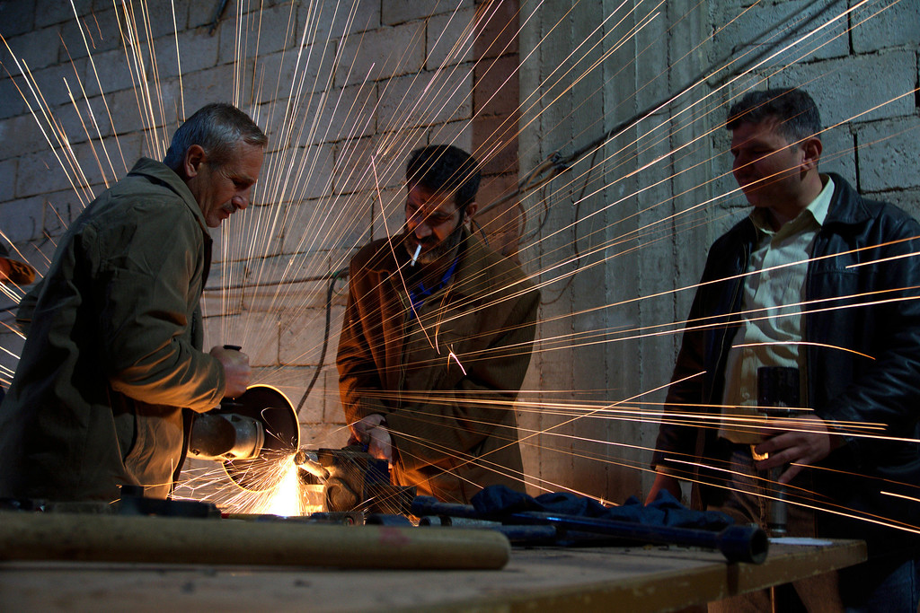 . Members of the Free Syrian Army work on an improvised mortar shell in Deir al-Zor March 8, 2013. REUTERS/ Khalil Ashawi