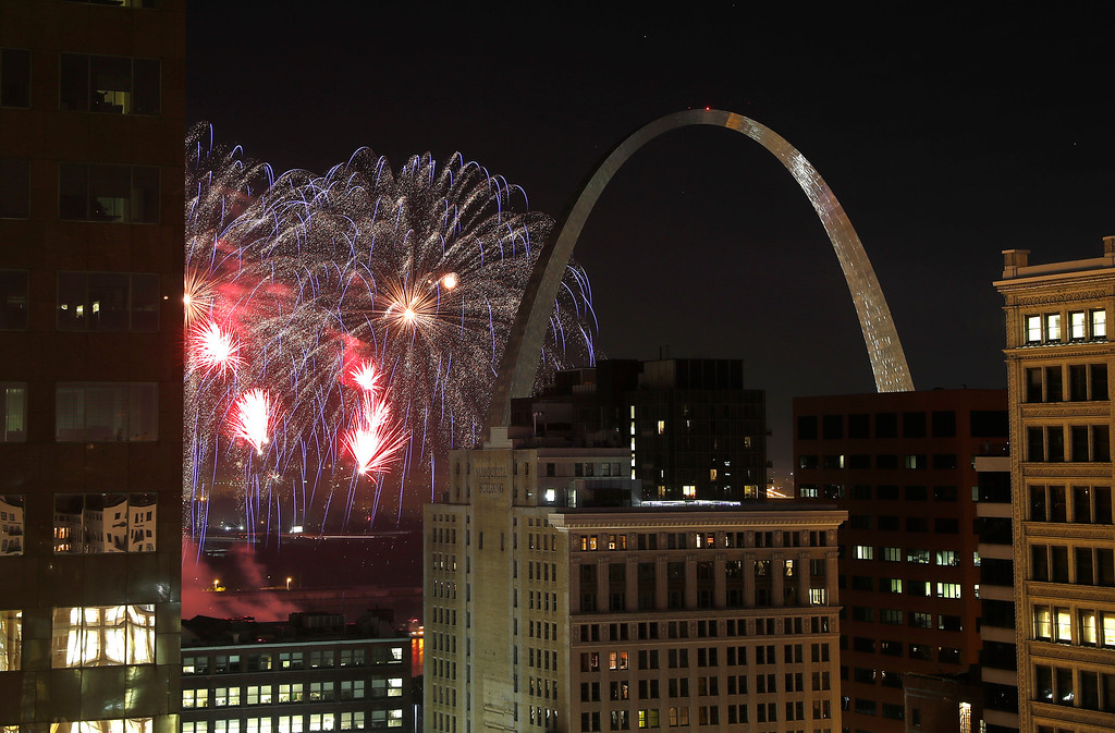 . Fireworks illuminate the night sky over the Gateway Arch Wednesday, July 4, 2018, in St. Louis. The fireworks are part Fair Saint Louis, the annual Independence Day celebration in the city. (AP Photo/Jeff Roberson)