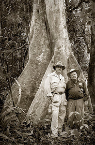 "Roger ""Mzungu"" Moore (Explorers Club, 2006)<br /> with his mentor, H. Morgan Smith (Explorers Club, 1954)<br /> Studying medicinal botanicals in the rainforest -<br /> Amazon River – Peru – July, 2005"