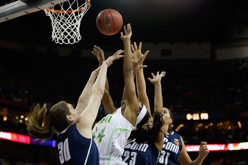 . Ariel Braker #44 of the Notre Dame Fighting Irish makes a shot over Breanna Stewart #30 of the Connecticut Huskies during the National Semifinal game of the 2013 NCAA Division I Women\'s Basketball Championship at the New Orleans Arena on April 7, 2013 in New Orleans, Louisiana.  (Photo by Chris Graythen/Getty Images)
