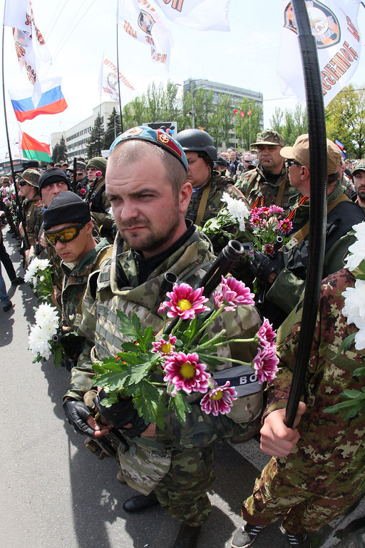 . Armed pro-Russia militiants take part in a rally marking Victory Day in eastern Ukrainian city of Donetsk on May 9, 2014. AFP PHOTO/ ALEXANDER  KHUDOTEPLY/AFP/Getty Images