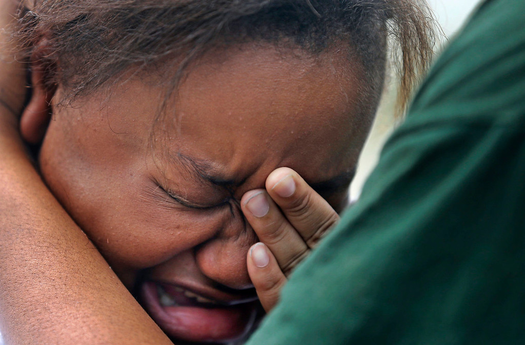 . Lisa North, the mother of missing 6-year-old Ahlittia North, cries in the arms of her mother, Rene\' Johnson, after she says Jefferson Parish authorities have found the body of her daughter in a Harvey trash bin, in Harvey, La., Tuesday, July 16, 2011. Ahlittia disappeared from her apartment late Friday night or early Saturday morning. North\'s husband Albert Hill said they were told the body was found in a trash bin not far from their apartment. (AP Photo/Gerald Herbert)
