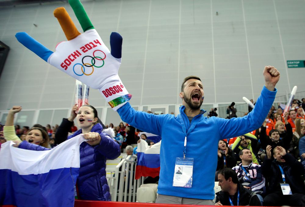 . A fan cheers during the Men\'s 5000m speed skating event at the 2014 Winter Olympics, Saturday, Feb. 8, 2014, in Sochi, Russia. (AP Photo/David J. Phillip )