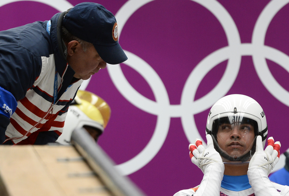 . Independent Olympic Participant Shiva Keshavan looks at his coach during the Men\'s Luge Singles run one at the Sliding Center Sanki during the Sochi Winter Olympics on February 8, 2014.  (LIONEL BONAVENTURE/AFP/Getty Images)