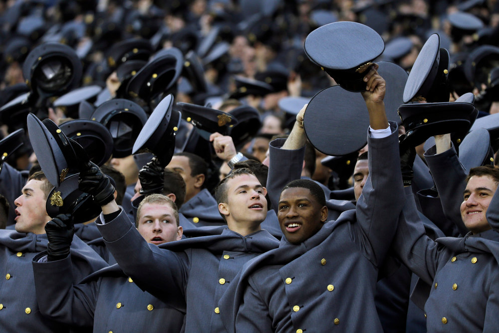 . Army Cadets cheer before the kickoff of an NCAA college football game against Navy, Saturday, Dec. 8, 2012, in Philadelphia. (AP Photo/Matt Slocum)