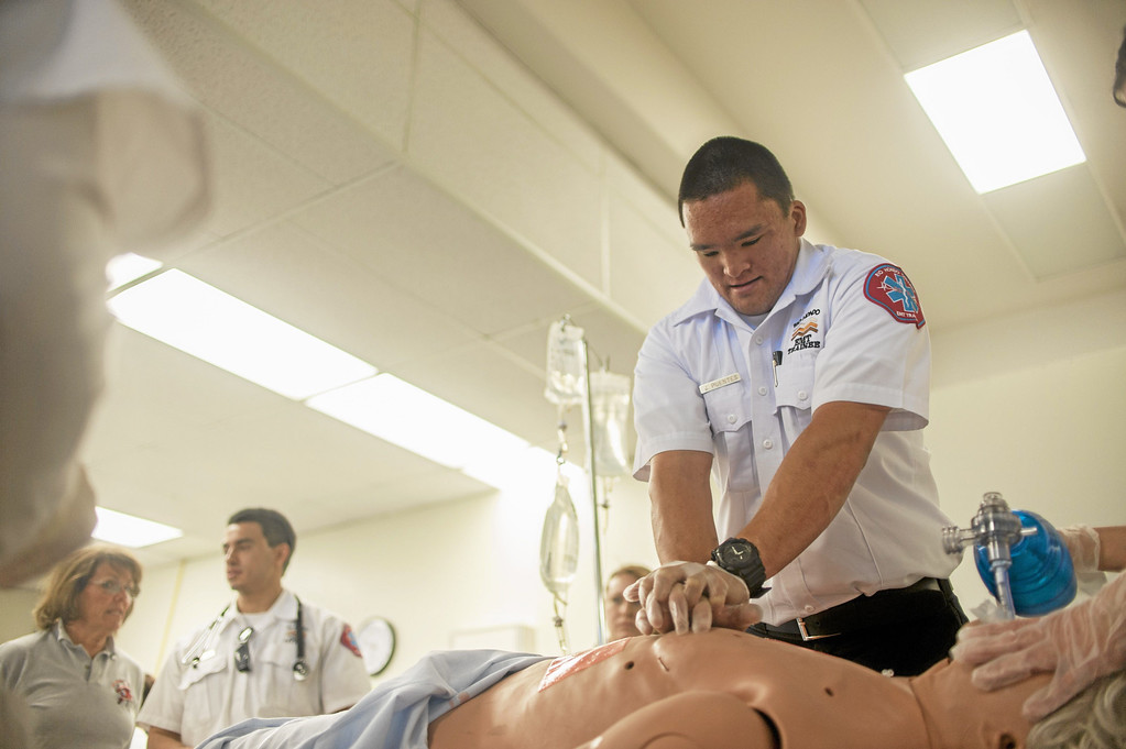 . Josh Puentes, an EMT student, performs chest compressions on a mock victim during a crisis drill at Rio Hondo College in Whittier on Friday, May 9, 2014. (Correspondent Photo by William Camargo)