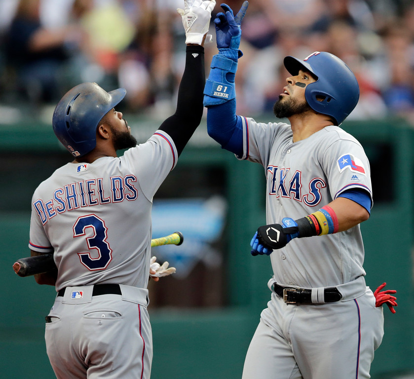 . Texas Rangers\' Robinson Chirinos, right, is congratulated by Delino DeShields after Chirinos hit a solo home run off Cleveland Indians starting pitcher Trevor Bauer in the fifth inning of a baseball game, Wednesday, June 28, 2017, in Cleveland. (AP Photo/Tony Dejak)