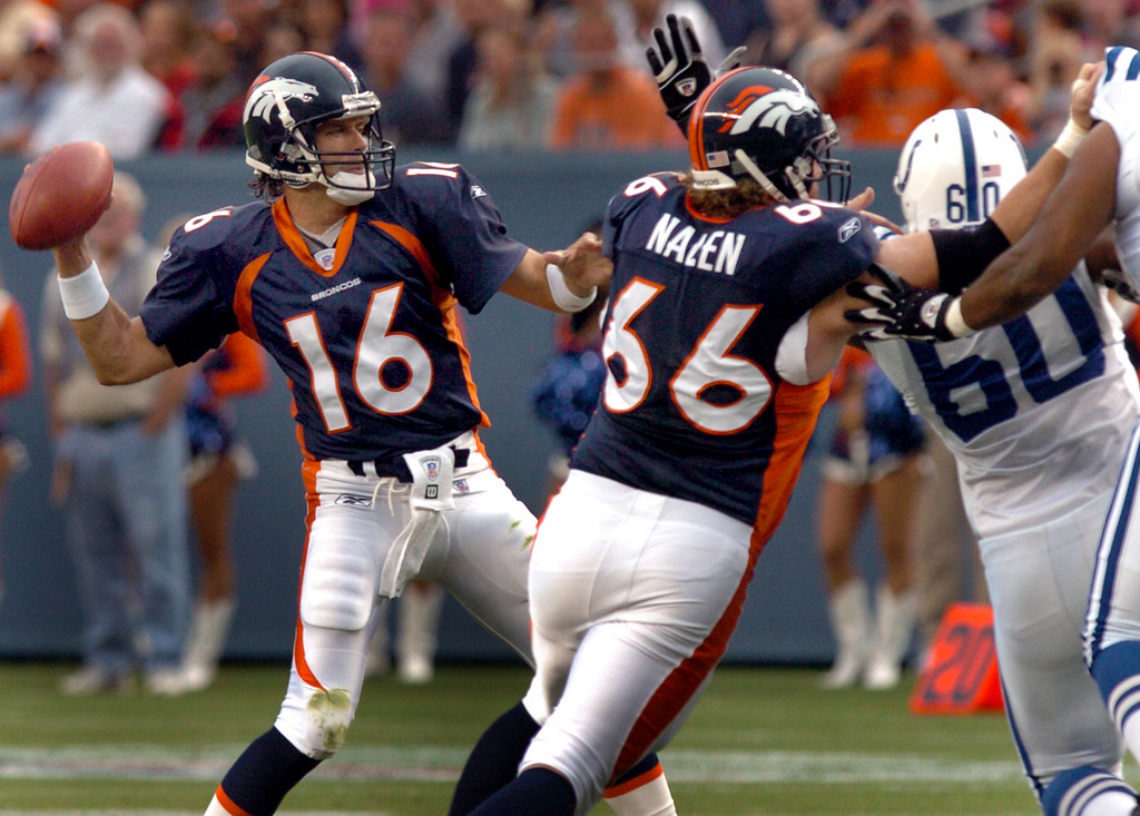 . Bronco QB Jake Plummer sets to throw as center Tom Nalen puts a block on the Colts #60 Darrell Reid in the 3rd qtr of the game between the Denver Broncos and the Indianapolis Colts on Saturday night August 27th, 2005 at Invesco Field at Mile High in Denver, Co.      DENVER POST PHOTO BY STEVE DYKES