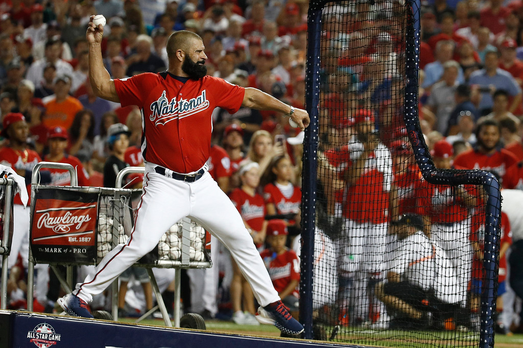 . Ron Harper pitches to his son Washington Nationals Bryce Harper during the MLB Home Run Derby, at Nationals Park, Monday, July 16, 2018 in Washington. The 89th MLB baseball All-Star Game will be played Tuesday. (AP Photo/Patrick Semansky)