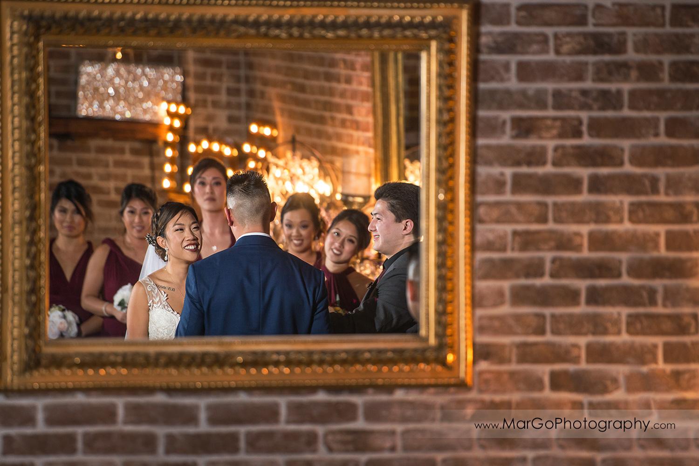 mirror shot of the bride during wedding ceremony at Sunol's Casa Bella