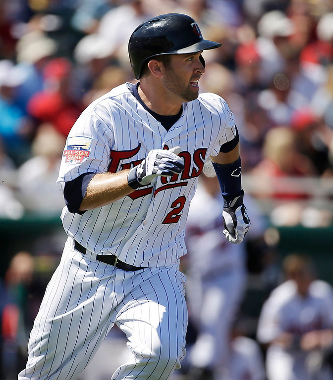 . Minnesota Twins\' Brian Dozier watches the flight of his double hit off Boston Red Sox pitcher Allen Webster while running to second in the first inning of an exhibition baseball game, Saturday, March 1, 2014, in Fort Myers, Fla. (AP Photo/Steven Senne)