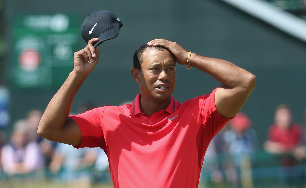 . Tiger Woods of the United States reacts on the 18th green during the final round of The 143rd Open Championship at Royal Liverpool on July 20, 2014 in Hoylake, England.  (Photo by Andrew Redington/Getty Images)