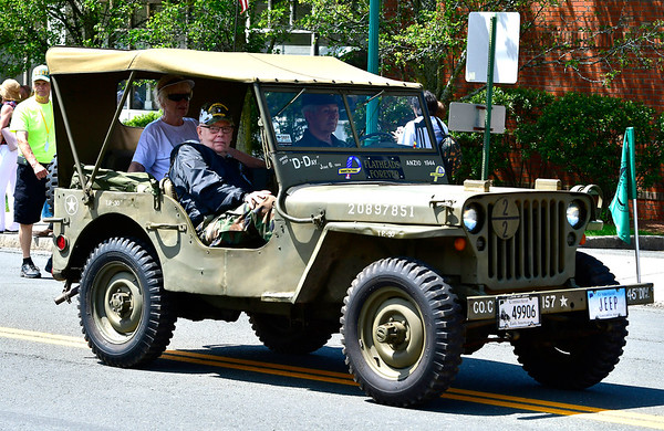 5/25/2019 Mike Orazzi | Staff Don Guay rides in the passenger seat of a 1943 Jeep Willys driven by Herman Schaber during the annual Newington Memorial Day parade on Saturday.