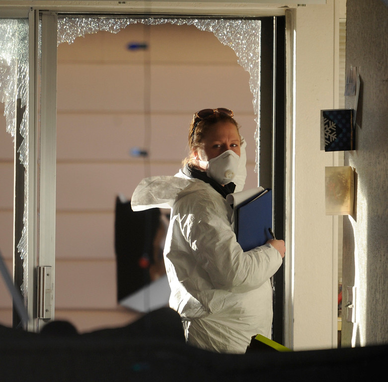 . Christmas cards were visible inside the Aurora townhome where Aurora crime investigators gathered evidence after four people died Saturday morning, January 5, 2013. Four people were killed including a gunman who held police at bay for several hours in an Aurora townhome. Neighbors identified the gunman as Sonny Archuleta. Karl Gehring/The Denver Post