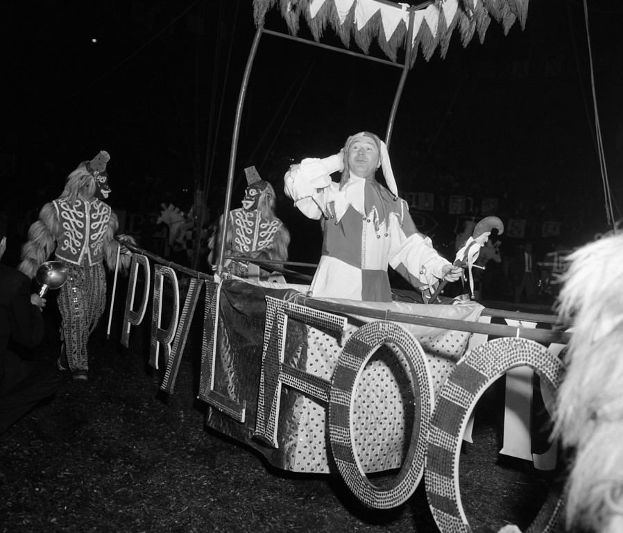 . Television comedian Red Buttons plays the part of April fool during parade of celebrities March 31 1934 during opening performance of Ringling Bros. and Barnum and Bailey Circus at Madison Square Garden in New York City. (AP Photo/Matty  Zimmerman)