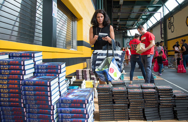09/04/19 Wesley Bunnell | StaffrrTwenty two thousand books were donated to area educators and parents with children by ESPN and Disney on Thursday September 4, 2019 at New Britain Stadium. Jennifer Shannon from Reggio Magnet School of the Arts in Avon looks through the books available.