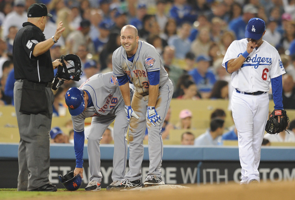 . Mets pitcher Dillon Gee reacts to sliding into 3rd base safely after hitting a triple in the 4th inning. The Dodgers play the New York Mets in a game at Dodger Stadium in Los Angeles, CA. 8/13/2013(John McCoy/LA Daily News)