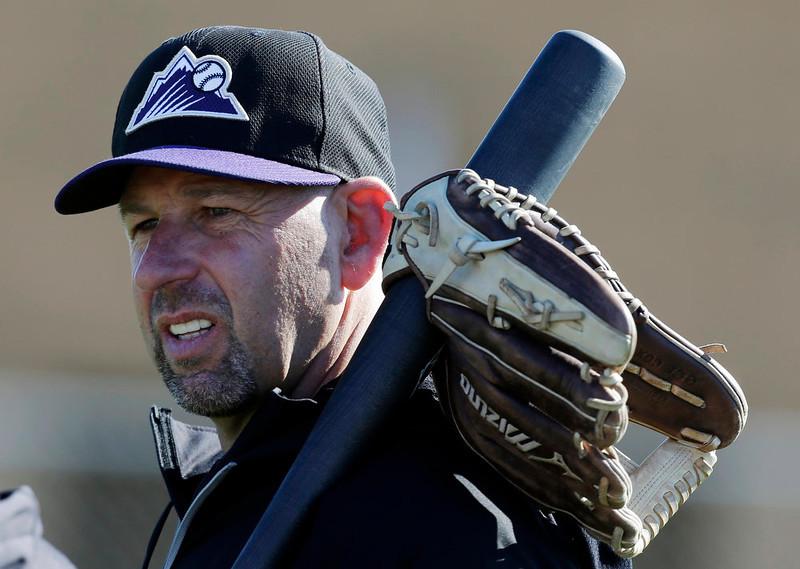 . Colorado Rockies manager Walt Weiss watches spring training baseball workout Tuesday, Feb. 12, 2013, in Scottsdale, Ariz. (AP Photo/Darron Cummings)