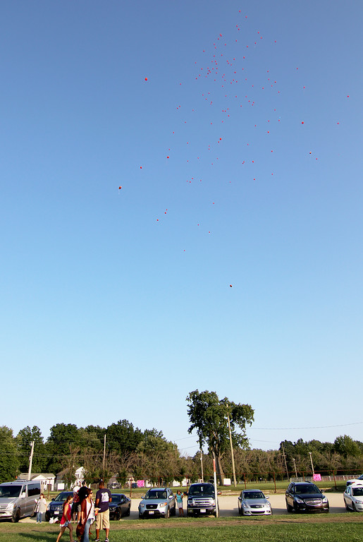 . Jonathan Tressler - The News-Herald. visitors to the Lake County Fairgrounds Aug. 25 watch as hundreds of red balloons, honoring those who�ve lost their lives to heroin drift skyward.