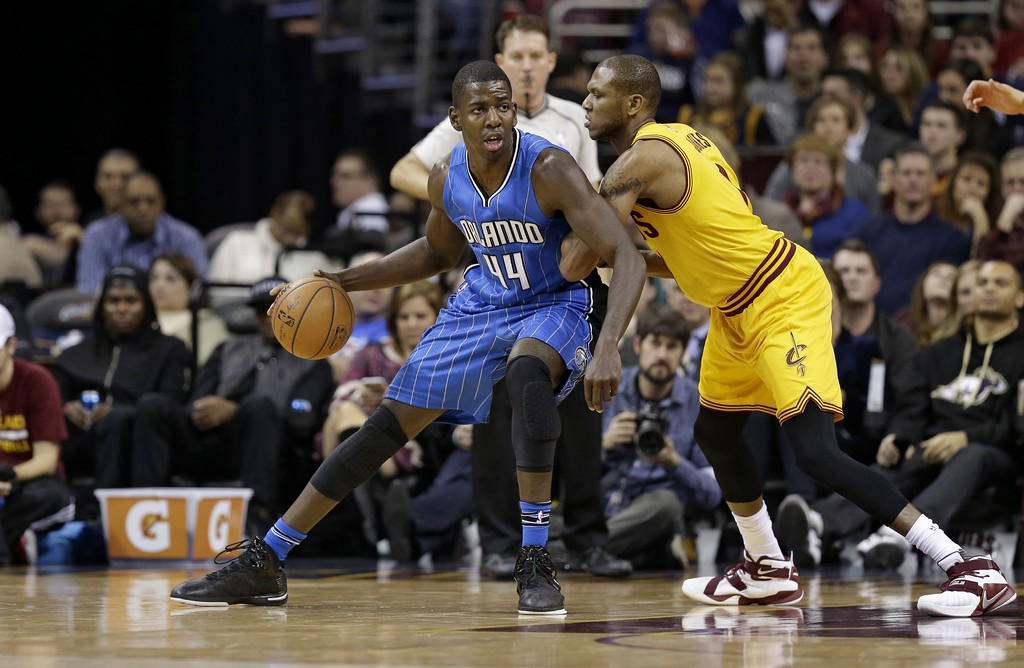 . Orlando Magic\'s Andrew Nicholson (44), from Canada, drives past Cleveland Cavaliers\' James Jones (1) in the first half of an NBA basketball game Saturday, Jan. 2, 2016, in Cleveland. (AP Photo/Tony Dejak)