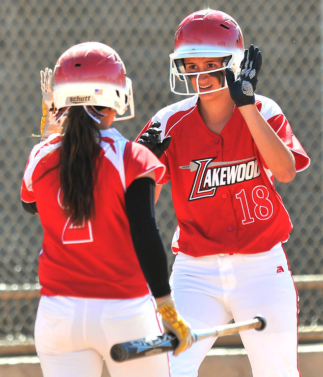 . LONG BEACH - 04/09/2013  (Photo: Scott Varley, Los Angeles Newspaper Group)  Lakewood vs Wilson girls softball at Joe Rodgers Field. Lakewood\'s Montana Dixon (18) is congratulated by Alexis Carrillo after Dixon hit a 3-run inside the park home run.