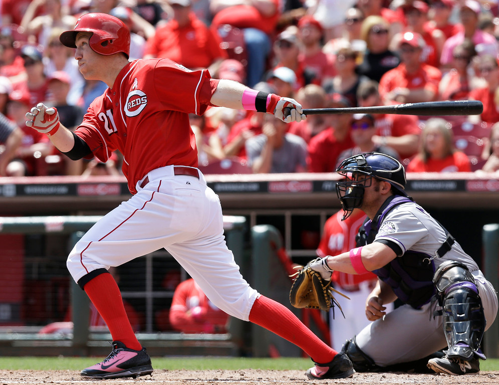 . Cincinnati Reds\' Todd Frazier (21) hits a solo home run off Colorado Rockies starting pitcher Juan Nicasio in the fourth inning of a baseball game, Sunday, May 11, 2014, in Cincinnati. Michael McKenry catches at right. (AP Photo/Al Behrman)