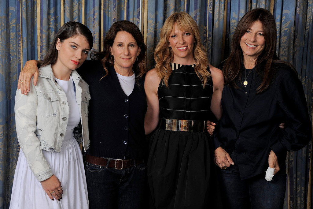 """. Wriet-director Nicole Holofcener, second from left, of the film \""""Enough Said,\"""" poses with cast members, from left, Eve Hewson, Toni Collette and Catherine Keener on day 4 of the 2013 Toronto International Film Festival on Sunday, Sept. 8, 2013 in Toronto. (Photo by Chris Pizzello/Invision/AP)"""