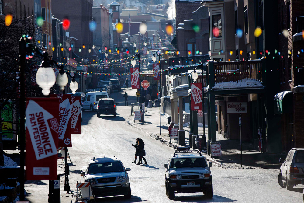Description of . Pedestrians cross Main St. as preparations continue on the first day of the Sundance Film Festival in Park City, Utah, January 17, 2013. REUTERS/Lucas Jackson
