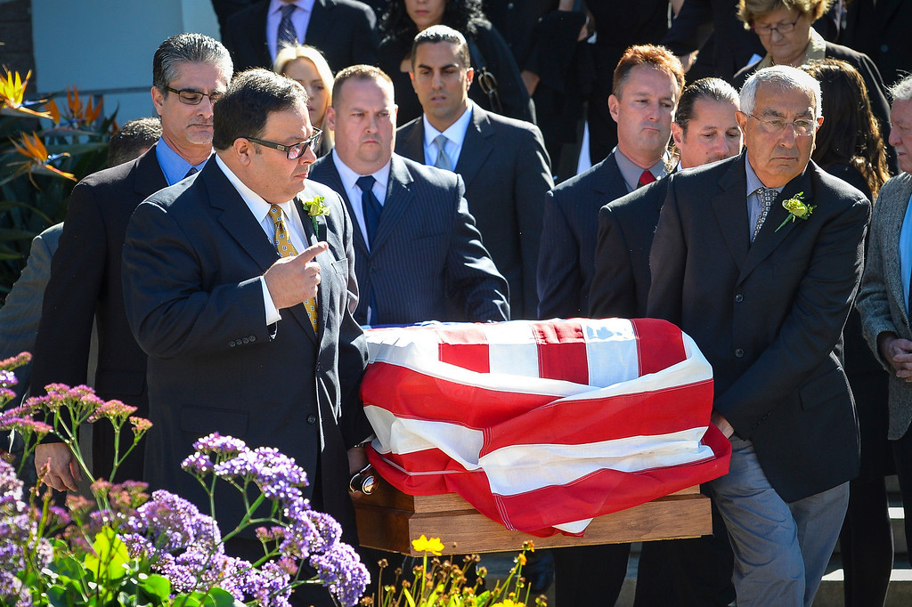 . The body of Joseph Gatto is transported to a hearse after services at Our Mother of Good Counsel Catholic church as his son, California Assemblyman Mike Gatto, follows on Monday November 25, 2013.  Joseph Gatto was found dead in his Silver Lake home on November 13th.    ( Photo by David Crane/Los Angeles Daily News )