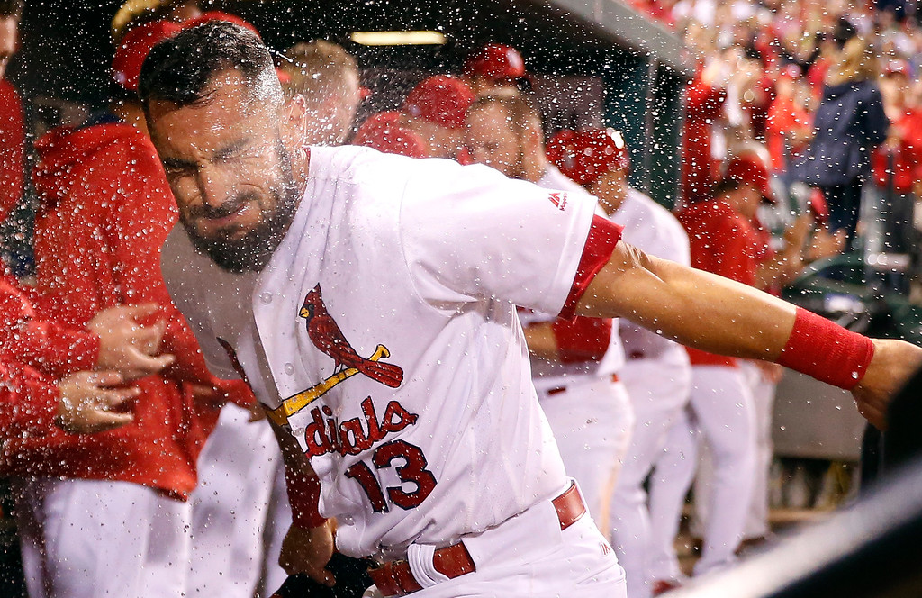 . St. Louis Cardinals\' Matt Carpenter is splashed with water by a teammate after hitting a three-run home run during the eighth inning of a baseball game against the Colorado Rockies Thursday, May 19, 2016, in St. Louis. (AP Photo/Jeff Roberson)