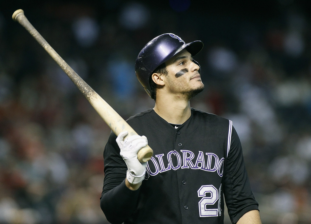 . Nolan Arenado #28 of the Colorado Rockies reacts after striking out against the Arizona Diamondbacks during the fourth inning of a MLB game at Chase Field on August 31, 2014 in Phoenix, Arizona.  (Photo by Ralph Freso/Getty Images)