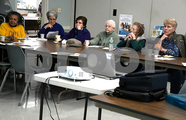 2/22/2018 Mike Orazzi | Staff Seniors listen to Cathy Sisco of Connecticut Clearinghouse/Wheeler Clinic during a discussion about the Opiod Epidemic held at the Plainville Senior Center Thursday morning.