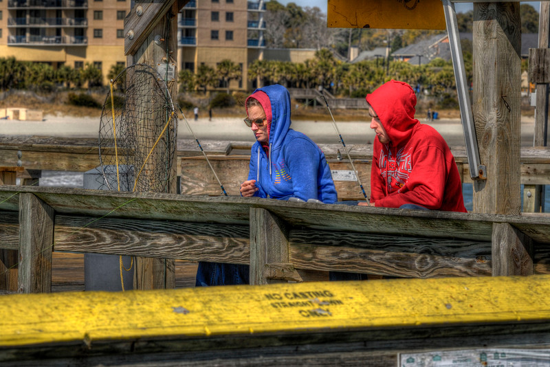 A couple enjoy fishing on a chilly winter day on the Apache Pier at the Apache Campground in Myrtle Beach, SC on Tuesday, March 6, 2012. Copyright 2012 Jason Barnette