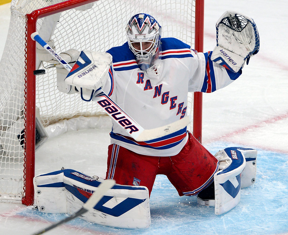 . New York Rangers goalie Henrik Lundqvist makes a save against the Montreal Canadiens during the first period in Game 2 of the NHL hockey Eastern Conference final Stanley Cup playoff series Monday, May 19, 2014 in Montreal. (AP Photo/The Canadian Press, Ryan Remiorz)