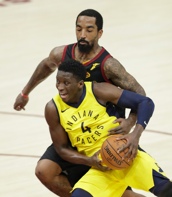 . Indiana Pacers\' Victor Oladipo (4) drives past Cleveland Cavaliers\' JR Smith during the second half of Game 2 of an NBA basketball first-round playoff series Wednesday, April 18, 2018, in Cleveland. The Cavaliers won 100-97. (AP Photo/Tony Dejak)