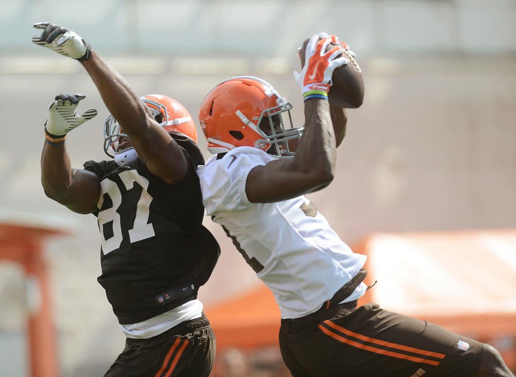 . Duncan Scott/DScott@News-Herald.com Barkevious MIngo makes an interception on a pass intended for tight end Emanuel Ogbuehi as the Cleveland Browns opened training camp on July 26 with their first practice at Browns headquarters in Berea.