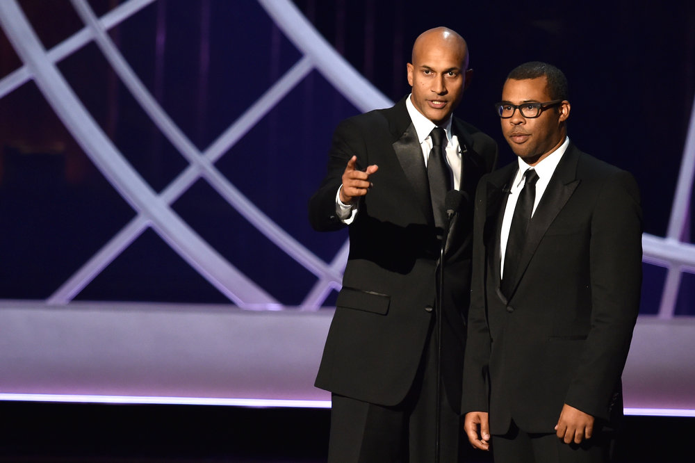 . Actors Keegan-Michael Key (L) and Jordan Peele speak onstage at the 66th Annual Primetime Emmy Awards held at Nokia Theatre L.A. Live on August 25, 2014 in Los Angeles, California.  (Photo by Kevin Winter/Getty Images)