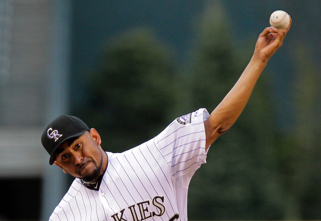 . Colorado Rockies starting pitcher Franklin Morales throws during the first inning of a baseball game, Tuesday, April 22, 2014, in Denver. (AP Photo/Barry Gutierrez)