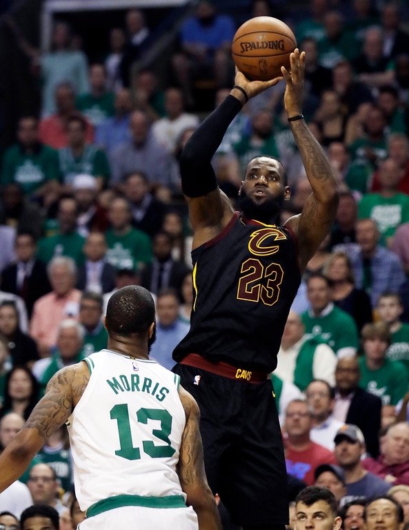 . Cleveland Cavaliers forward LeBron James shoots over Boston Celtics forward Marcus Morris (13) in the second quarter of Game 5 of the NBA basketball Eastern Conference Finals, Wednesday, May 23, 2018, in Boston. (AP Photo/Charles Krupa)